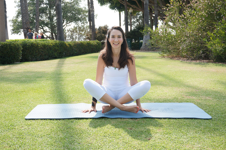 Private Yoga Instructor Los Angeles Santa Monica Brentwood Pacific Palisades Bel Air Venice Marina del Rey Lifted Lotus Pose